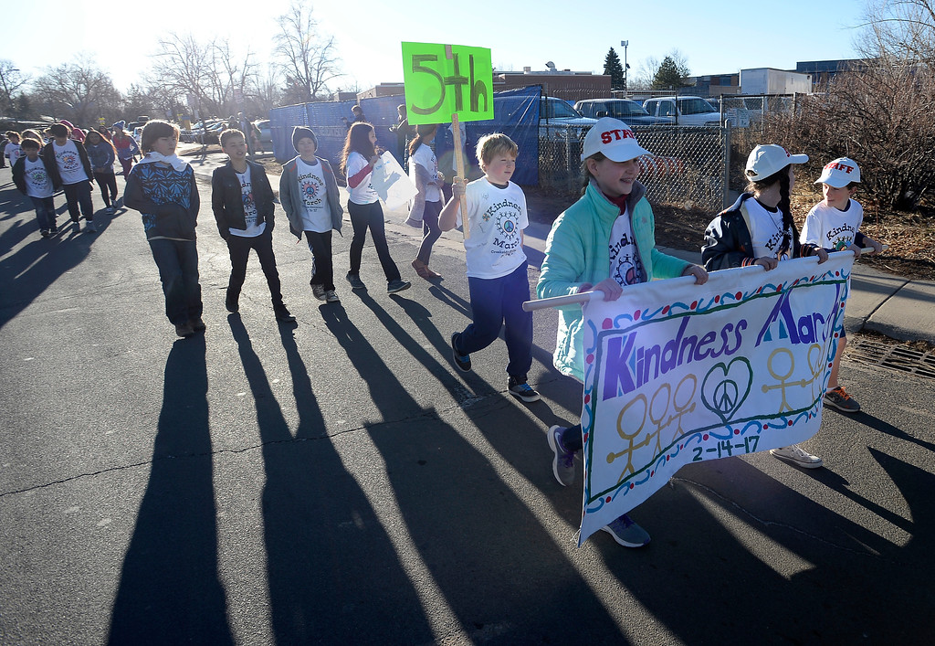 . Lila Nuttle, left, Madi Arnold, and Grant Simms lead Creekside students on a march outside their school.  Creekside Elementary  5th graders, Madi Arnold and Lila Nuttle, and 4th grader Grant Sims, led a Kindness March outside the school to celebrate diversity and kindness. For more photos, and a video, go to www.dailycamera.com. Cliff Grassmick  Staff Photographer  February 14, 2017