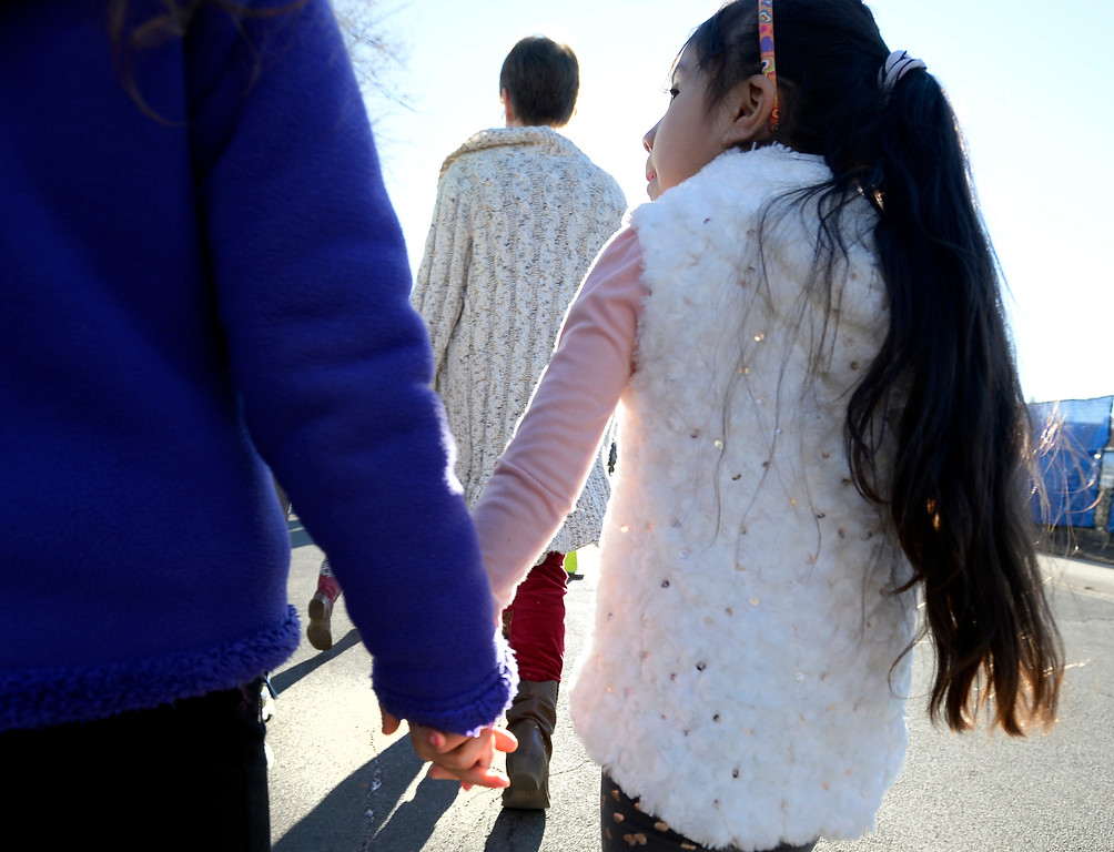 . Bruna Dalpian, left, and Camila Valdez Argumedo, hold hands during the kindness march. Creekside Elementary  5th graders, Madi Arnold and Lila Nuttle, and 4th grader Grant Sims, led a Kindness March outside the school to celebrate diversity and kindness. For more photos, and a video, go to www.dailycamera.com. Cliff Grassmick  Staff Photographer  February 14, 2017