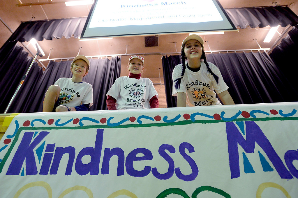 . Grant Sims, left, Lila Nuttle, and Madi Arnold, prepare to start their kindness program. Creekside Elementary  5th graders, Madi Arnold and Lila Nuttle, and 4th grader Grant Sims, led a Kindness March outside the school to celebrate diversity and kindness. For more photos, and a video, go to www.dailycamera.com. Cliff Grassmick  Staff Photographer  February 14, 2017