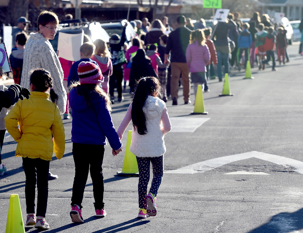 . Creekside Elementary  5th graders, Madi Arnold and Lila Nuttle, and 4th grader Grant Sims, led a Kindness March outside the school to celebrate diversity and kindness. For more photos, and a video, go to www.dailycamera.com. Cliff Grassmick  Staff Photographer  February 14, 2017