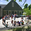 Kids and their families gather to draw inspirational messages on rocks at the Lunenburg Public Library on Monday which are to be displayed in nature throughout the community. SENTINEL & ENTERPRISE JEFF PORTER