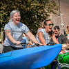 """At left, Gina Tacconi-Moore of Lowell and Amanda Leahy of Lowell ride their """"Midnight Machine"""" which they made in 10 hours overnight for the Kinetic Races in Lowell. SUN/Caley McGuane"""
