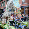 Team members Stephanie Laflamme of Westford, Alex Serrano of Pennsylvania, Adam Robinson of Lowell and Amy Bienta of Lowell pedal their way through the Kinetic Race on their sculpture. SUN/Caley McGuane