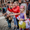Halianna Gacek, 10, of Lowell and Kaia Clark, 7, of Lowell cheer for candy being tossed out during the Kinetic Races in Lowell. SUN/Caley McGuane