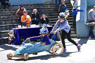 The Blue Goo Pointe Shoe takes a  victory lap after finishing its  race with Nyrie Broderick, 10, pushing Amira Wanden, 10 in the last  moments of their race.  (Jose Quezada - For the Times-Standard)