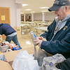 The Knights of Columbus Council 99 on Electric Avenue in Fitchburg held a food drive on Saturday, March 21, 2020. They brought the food they collected to St. Francis of Assisi, on Sheridan Street in Fitchburg, who have had a food pantry on Friday's from 12 p.m. to 2 p.m. Their food pantry at the church has been around for over 40 years. Sorting through the food is Harry Hakala KoC financial secretary. SENTINEL & ENTERPRISE/JOHN LIOVE
