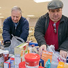 The Knights of Columbus Council 99 on Electric Avenue in Fitchburg held a food drive on Saturday, March 21, 2020. They brought the food they collected to St. Francis of Assisi, on Sheridan Street in Fitchburg, who have had a food pantry on Friday's from 12 p.m. to 2 p.m. Their food pantry at the church has been around for over 40 years. Sorting through the food is Tony Catalfamo St. Vincent de Paul Conference president with St. Francis of Assisi Parish and Chris Miller Deputy Grand Knight of the KoC. SENTINEL & ENTERPRISE/JOHN LIOVE