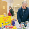 The Knights of Columbus Council 99 on Electric Avenue in Fitchburg held a food drive on Saturday, March 21, 2020. They brought the food they collected to St. Francis of Assisi, on Sheridan Street in Fitchburg, who have had a food pantry on Friday's from 12 p.m. to 2 p.m. Their food pantry at the church has been around for over 40 years. Sorting through the food is Tony Catalfamo St. Vincent de Paul Conference president with St. Francis of Assisi Parish. SENTINEL & ENTERPRISE/JOHN LIOVE