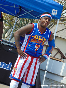 This is Too Tall, named so because he is the shortest Globetrotter on the team.