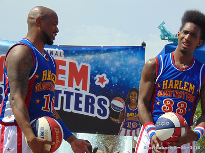 When I was growing up I remember the Globetrotters all being African American men, but if you look at the banner behind them, there are women on the team now. There are five or six women and one of them is even white.  Although the worls still hasissues and a long way to go to get them corrected, there have diffenitly been some improvements since the old days in the issues of equality and inclusion.