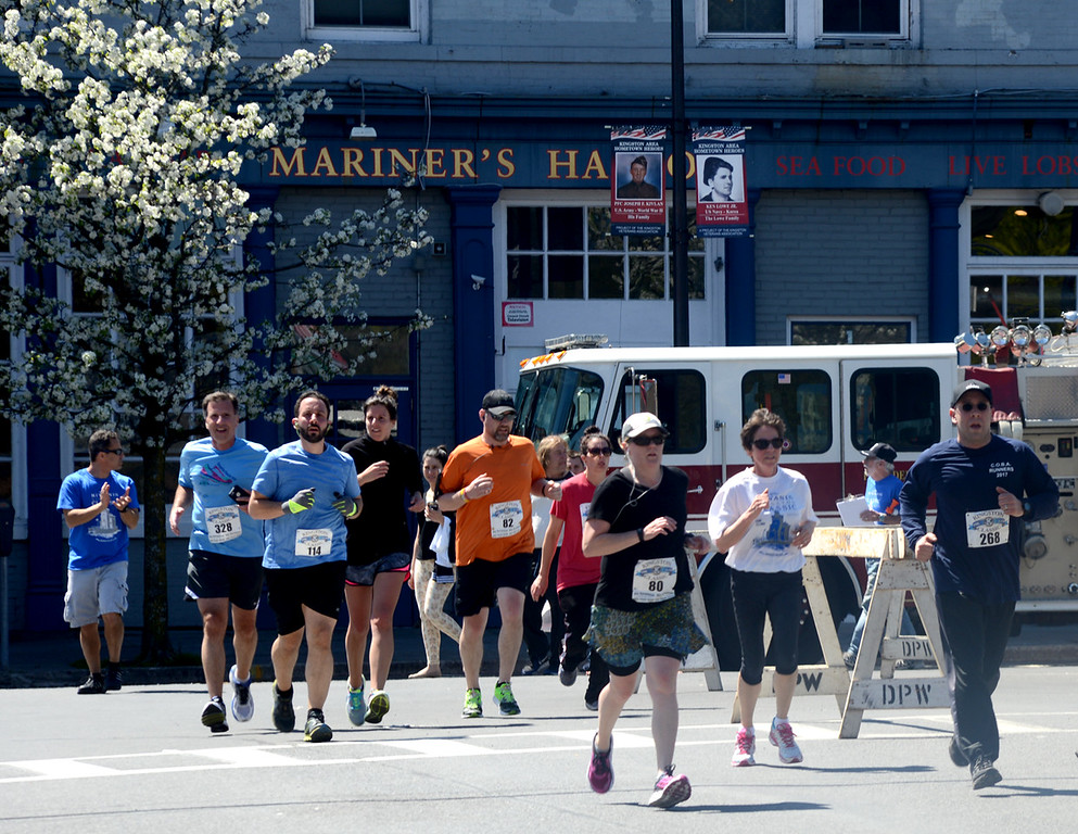 . Tania Barricklo-Daily Freeman                      Runners take the turn at the end of Broadway in Kingston, NY onto East Strand heading out to Rotarty Park during the Kingston Classic 10K Sunday.