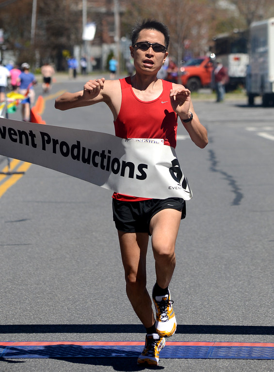 . Tania Barricklo-Daily Freeman                      Kingston Classic defending champion Mike Chow of Wappingers Falls at the finish of the 10K.