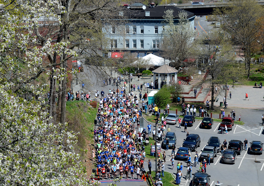 . Tania Barricklo-Daily Freeman                      Over four hundred people gather at the start of the 10K Kingston Classic Sunday which moved its location to the Rondout in Kingston, N.Y.