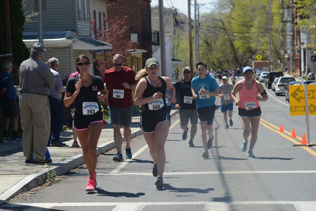 . Runners make their way up Abeel Street in Kingston before turning onto the Rondout Creek Bridge in April 23\'s Kingston Classic. Photo by Tania Barricklo�Daily Freeman.