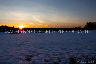 Sunset across a snow covered Field