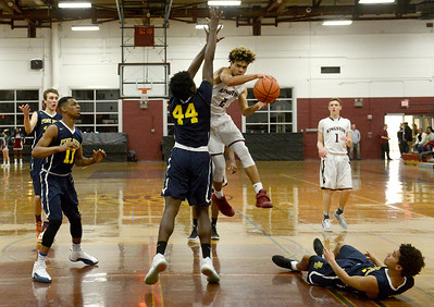 Tania Barricklo-Daily Freeman                      Kingston's Tre'Shon Rashada attempts to pass the ball around Pine Bush's D'Alton Dixon.