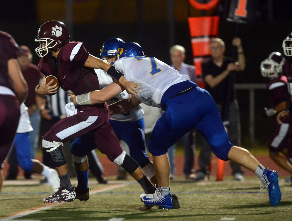 . Tania Barricklo-Daily Freeman                      Kingston\'s quarterback Chapman Parker is taken down by Washingtonville\'s defensive lineman Dillon Sullivan.