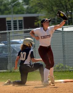 Tania Barricklo-Daily Freeman                      Kingston first baseman Kate Schrowang Newburg Danielle Scarano makes it back safely