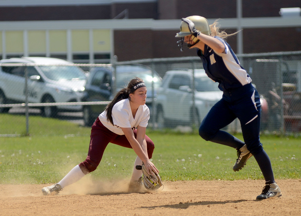 . Tania Barricklo-Daily Freeman  Kingston first baseman Kate Schrowang scoops up the hit, getting Newburgs\'s Taylor Ricciardi out at second.