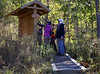 HOLLY PELCZYNSKI - BENNINGTON BANNER Hikers excitedly look at the new bald mountain trail head kiosk before hiking to the white rocks on Friday in Bennington.