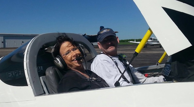 March 25, 2017. Speaking of Cynthia Collier, here she is about to get her first ride in my airplane (after my sister went). I worked at Leland Collier Electric company as a teenager (Cynthia's parents started it).  She still works there, and of course that's where we went in the air so she could see it.  Cynthia and my sister were college roomates.