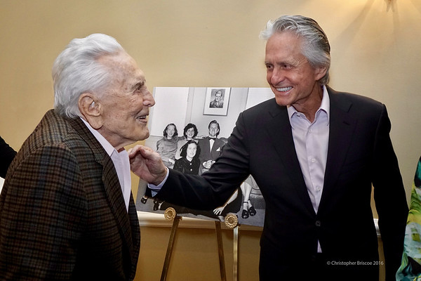 Kirk Douglas during his 100th birthday party, with his son, Michael Douglas.
