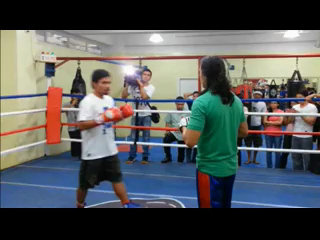 Mr. Pacquiao during a punch mitt  training session with MP towers boxing club principal trainer Ericxon Asilo Sept. 2013