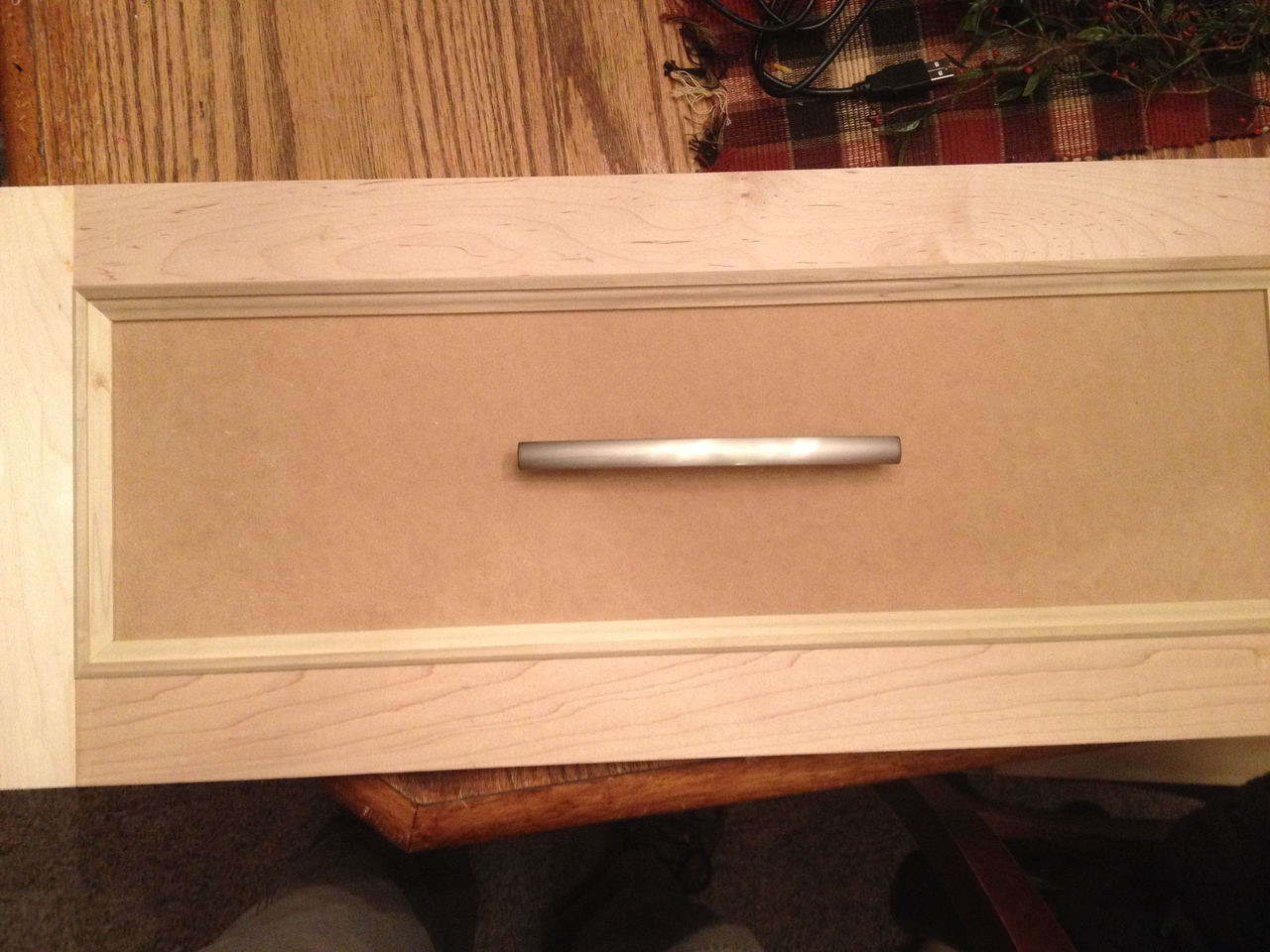 Drawer front with the trim pieces dry-fitted & test look of drawer pull.