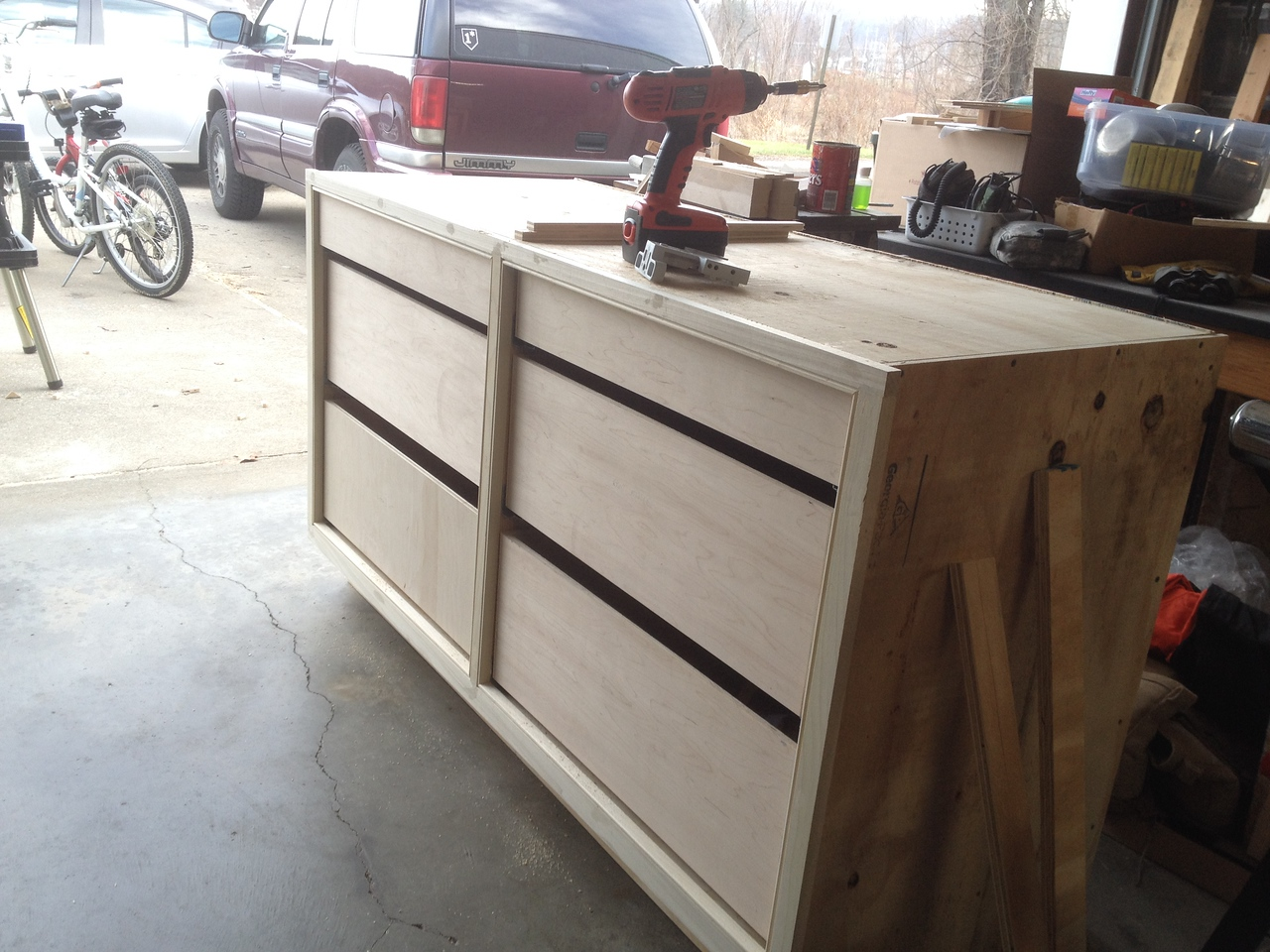 12/22/14<br /> All drawers installed, sans drawer fronts.