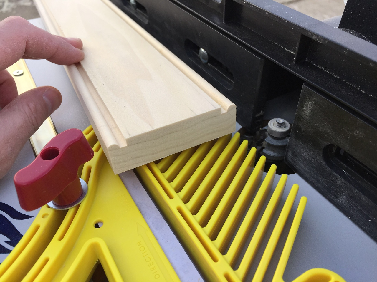 "The next day I planed down some more poplar & squared up the edges.<br /> I had to make more beaded trim to go around the frame openings.<br /> ""Let me show you how I make it.""<br /> To make it, first I ran each edge of the 3/4"" thick board through my router table with a beading bit installed."