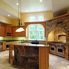 Corbels and posts hold up the heavy granite overhang on the kitchen bar.