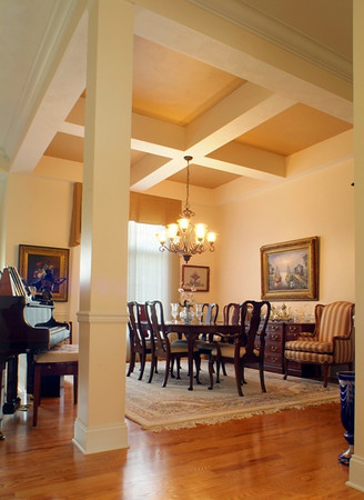Deep coffered ceilings highlight this dining space.