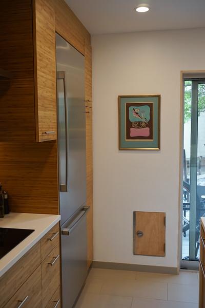 We added in a doggie door for Goose.