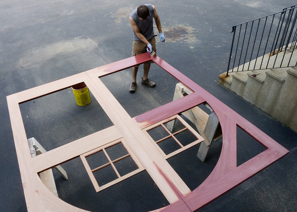 Dave applies stain to one of the barn doors