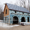 The barn awaits metal roofing