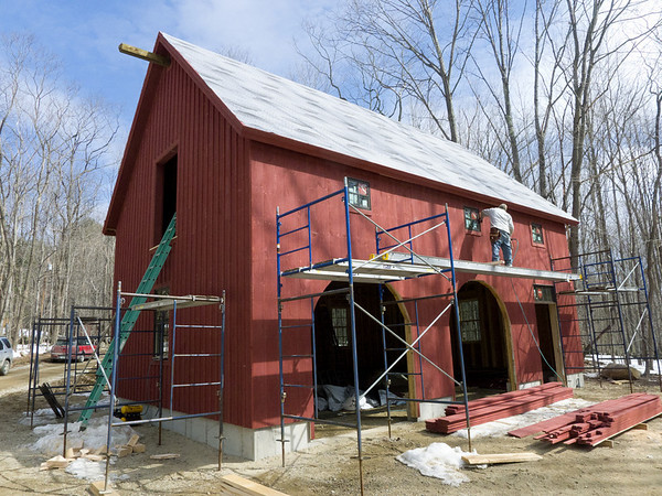Barn siding is now up, with battens and trim details going up now