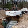 Top half of septic tank goes on