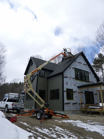 Lift to help placement of solar panels high up on the roof