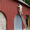 Final coat of stain at the barn