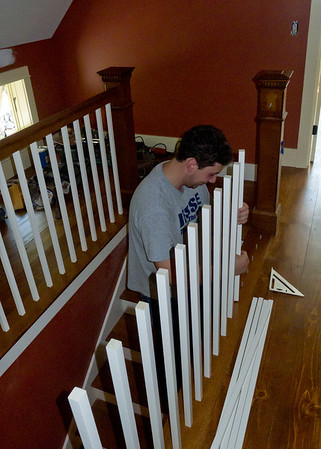 Jesse installing last of the stair rail spindles