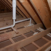 Attic view of foam insulation around ceiling penetrations