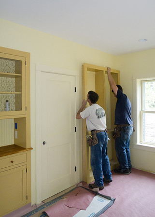 Brett & Jesse install the Dining Room bookcase (built in our shop)
