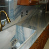 Kitchen Tops in Azul Imperial and Stone Vegetable Sink by Schlitzberger Stone Designs