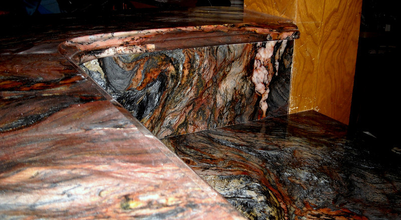 A Kitchen High Bar and Low Bar Top in Blue Fusion by Schlitzberger Stone Designs