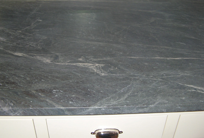 This is actually honed granite that looks like soapstone!  Wow.  It's beautiful - came from Gerrity stone in Mass