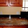A Completed Rainforest Brown Kitchen Countertop by Schlitzbeger