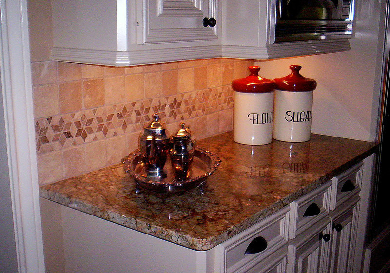 A Kitchen Top with Geometric Tile Splashes by Schlitzberger Stone Designs