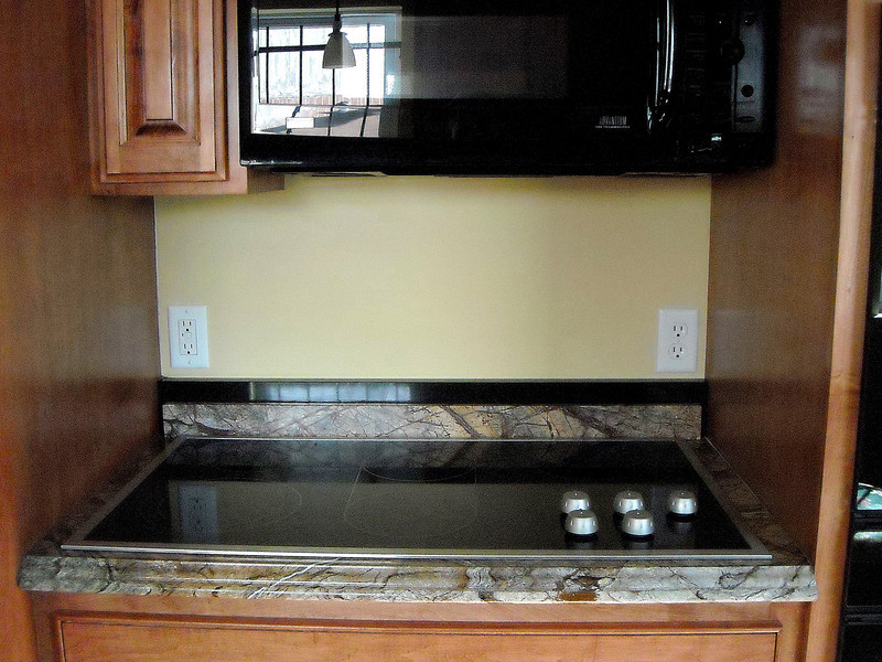 A Completed Rainforest Brown Kitchen Cooktop by Schlitzberger