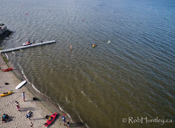 Swimmers and support boats arriving. Ottawa Riverkeeper 4K Swim. Kite aerial photograph.