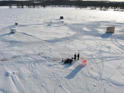 Ice Fishing near Petrie Island on the Ottawa River.